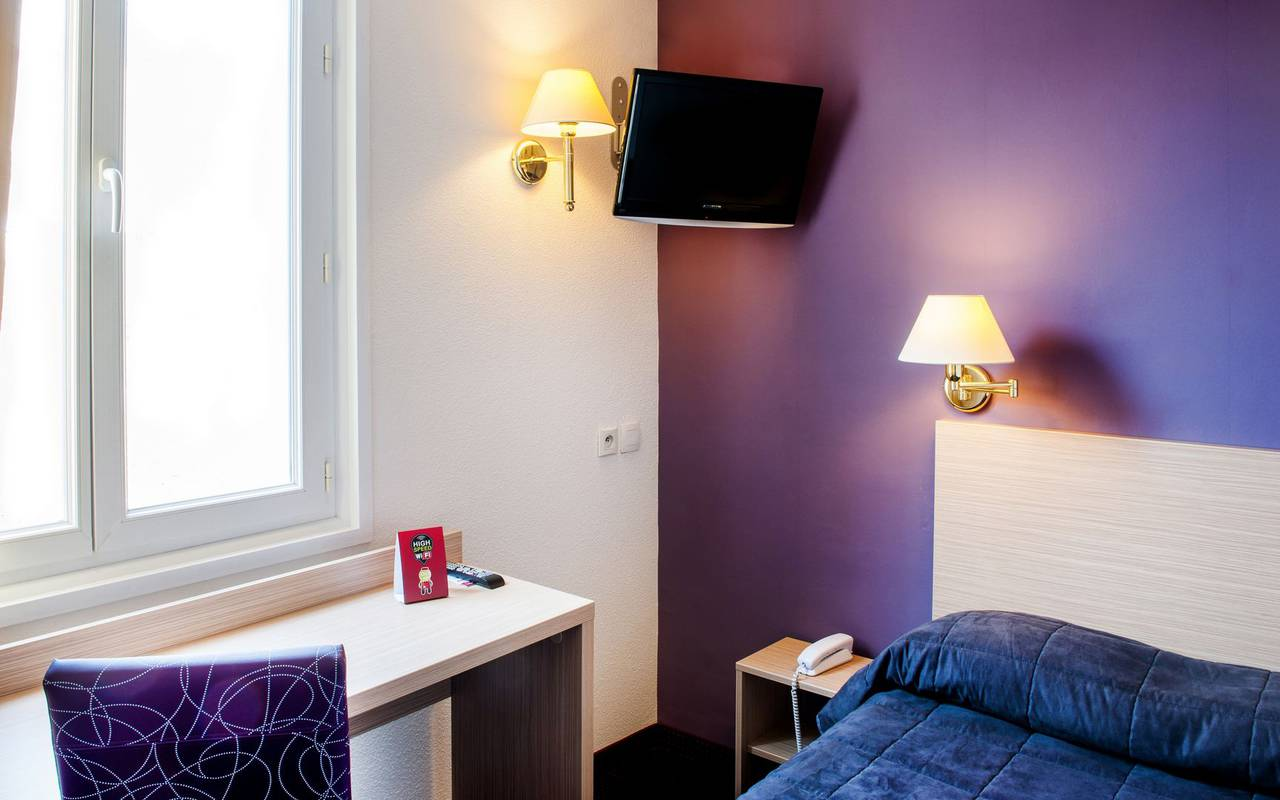 Bedroom with office area, bed and breakfast in Lourdes, Hôtel Continental Lourdes